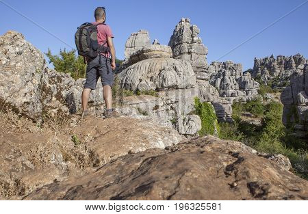 Man staring on rocky hill at Torcal de Antequera Malaga Spain