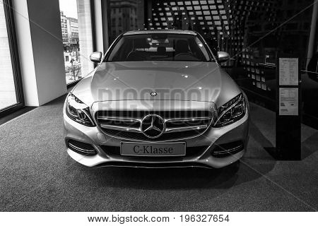 BERLIN - JANUARY 24 2015: Showroom. Compact executive car Mercedes-Benz C220 BT Limousine. Black and white. Produced since 2014.