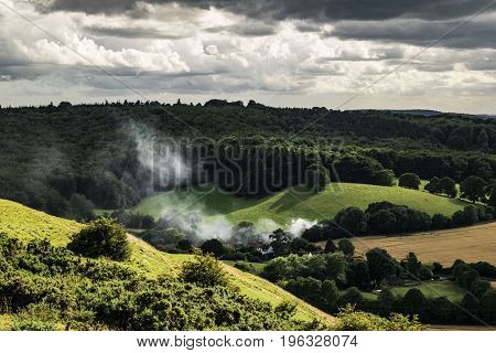 Cloudy,dark summer day.view from Clay Hill in England close Warminster.