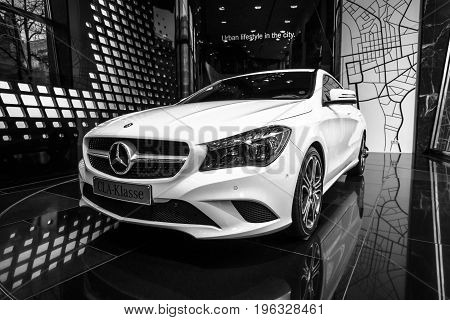 BERLIN - JANUARY 24 2015: Showroom. Compact executive car Mercedes-Benz CLA200. Black and white. Produced since 2013.