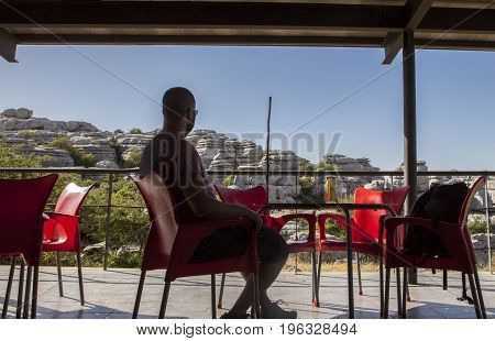 Man resting on interpretive centre restaurant at Torcal de Antequera Malaga Spain