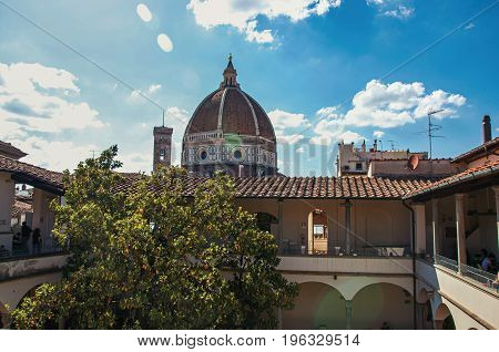 Rooftop view in building and Cathedral dome with sunny blue sky in the city of Florence, the famous and amazing capital of the Italian Renaissance. Located in the Tuscany region