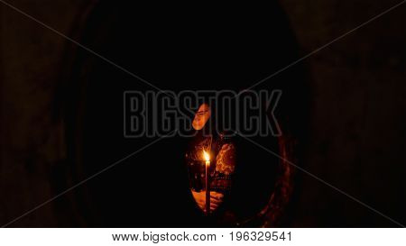 Jerusalem, Israel - May 25, 2017: People in the Jesus Empty tomb in Jerusalem in the Holy Sepulcher Church. View through window. The Church and Empty Tomb the most sacred places for all Christians.