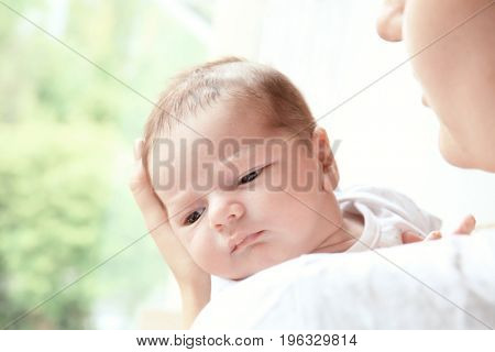 Newborn baby boy with mother at home