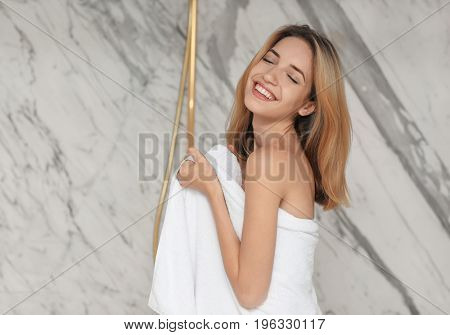 Beautiful young woman going to take shower in bathroom