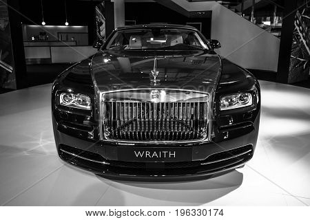 BERLIN - MARCH 08 2015: Showroom. Full-size car Rolls-Royce Wraith (2013). Black and white. Rolls-Royce Motor Cars Limited global manufacturer of luxury cars.