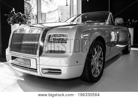 BERLIN - MARCH 08 2015: Showroom. Luxury car Rolls-Royce Phantom Drophead Coupe. Black and white. Rolls-Royce Motor Cars Limited global manufacturer of luxury cars.