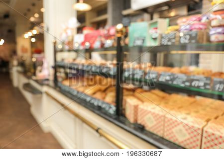 Blurred view of counter with bakery products in shop