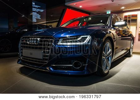 BERLIN - MARCH 08 2015: Showroom. Full-size luxury car Audi S8. Audi AG is a German automobile manufacturer.