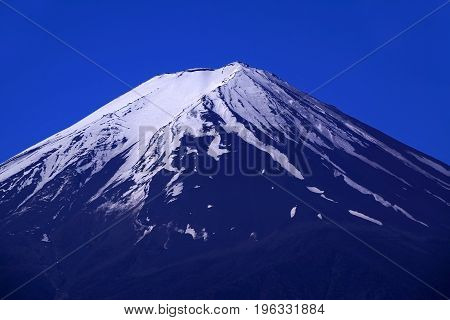 Morning Close-up Of Symmetric Mount Fuji With Snow And Clear Blue Sky In Japan.