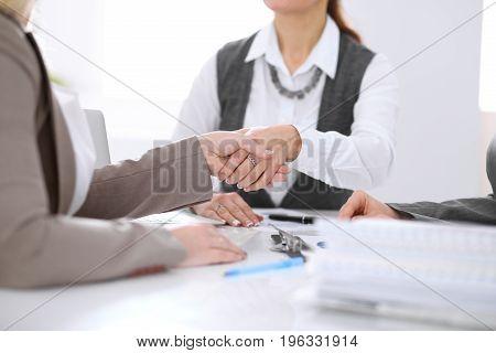 Handshake of business people in negotiations in office