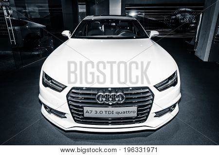 BERLIN - MARCH 08 2015: Showroom. Executive car/mid-size luxury car Audi A7 3.0 TDI quattro (2014). Toning. Stylization. Audi AG is a German automobile manufacturer.