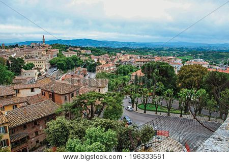 Overview of roofs and buildings in the city of Perugia, a historic and touristic city famous for its cultural agenda and the production of chocolate. Located in the Umbria region, central Italy