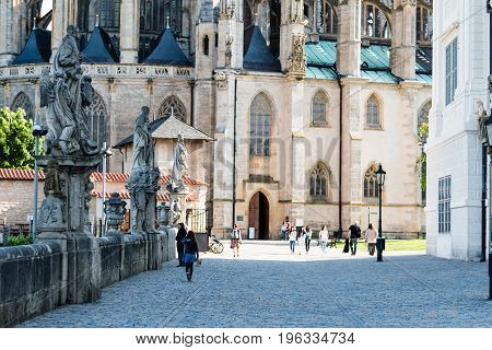 KUTNA HORA CZECH REPUBLIC - MAY 21 2017: The tourists in front of the Saint Barbara's Church.