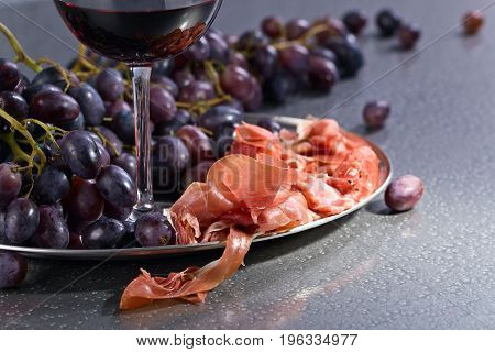 Prosciutto With Grape And Red Wine .
