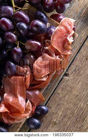 Prosciutto With Blue Grape .