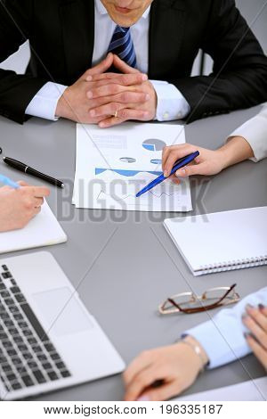 Close up of business people at meeting.