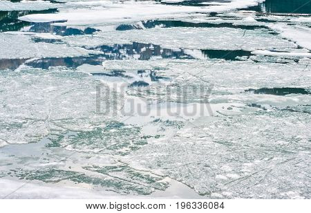Frozen Ice scattered All Over a Lake
