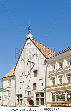 Tallin, Estonia-July 7, 2017: Streets of Tallin, with an old warehouse showing the use of decorative metals reinforcements in the walls and the use of a hoist to raise goods to the upper stories