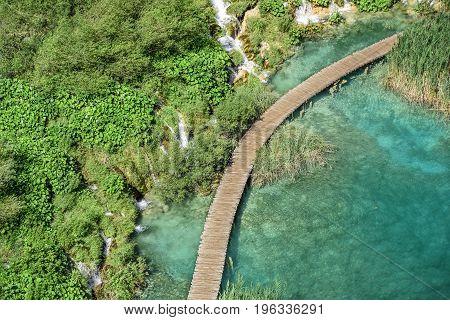 Wooden walkways through the lakes, top view. National Park Plitvice Lakes. Croatia.