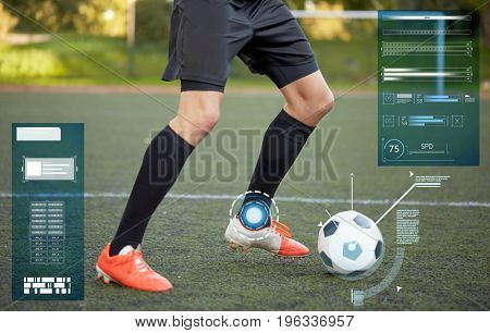 sport, technology and people concept - soccer player playing with ball on football field