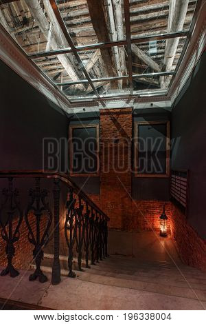 Modern industrial creative workspace. staircase with textured brick walls to the attic loft. night club