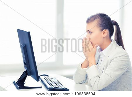 picture of stressed student with computer in office