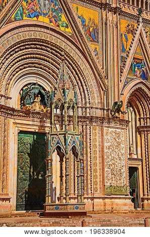 Facade details of the opulent and monumental Orvieto Cathedral (Duomo) on a sunny day in Orvieto, a pleasant and well preserved medieval town. Located in Umbria, central Italy. Retouched photo