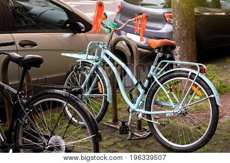 Beautiful vintage hipster bicycle parked in city