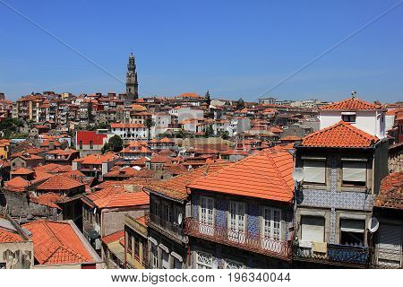 Beautiful facades and roofs of houses in Porto, Portugal, and the bell tower of Torre dos Clerigos