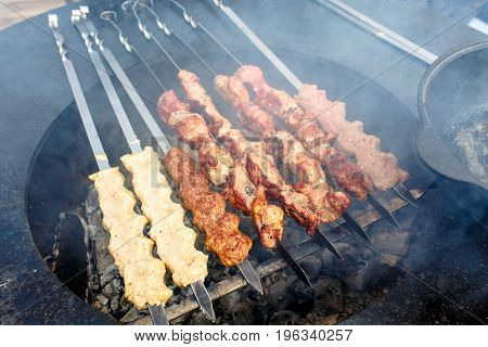 Kebabs And Kebabs Roasted On Skewers On The Grill