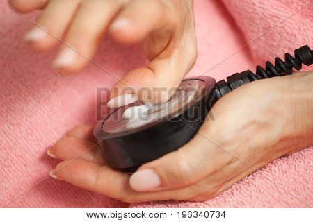 Ultrasound Treatment On The Thumb.