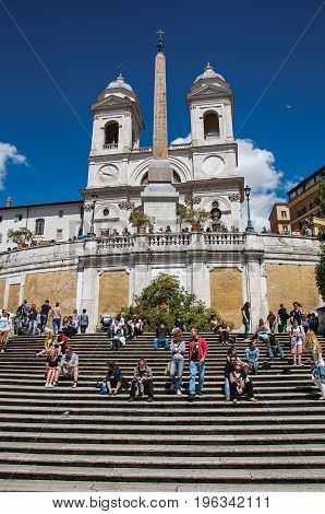 Roma, Italy - May 19, 2013. Spanish Steps with the Trinità dei Monti church at the top in Rome, the incredible city of the Ancient Era, known as