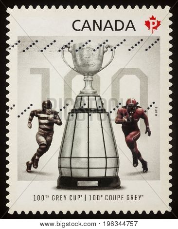 Moscow Russia - July 21 2017: A stamp printed in Canada shows Grey Cup - the trophy of Canadian Football League (CFL) series
