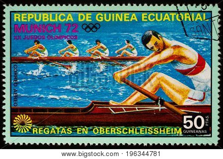 Moscow Russia - July 21 2017: A stamp printed in Equatorial Guinea shows competition in academic rowing series