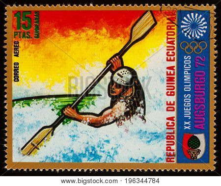 Moscow Russia - July 21 2017: A stamp printed in Equatorial Guinea shows kayaking on a mountain river series