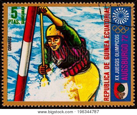 Moscow Russia - July 21 2017: A stamp printed in Equatorial Guinea shows canoeing on a mountain river series