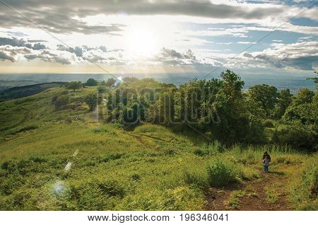 Overview of people walking through fields and hills in the sunset near the town of Frascati, a pleasant and well known place for its fine wines, near Rome. Located in the Lazio region, central Italy