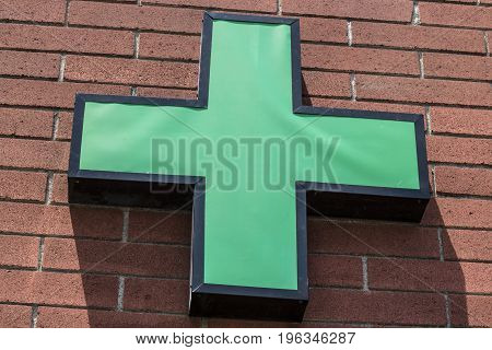 Las Vegas - Circa July 2017: Green Cross sign. The green cross is a common symbol used in the marijuana community. A number of states have legalized pot for recreational use IV