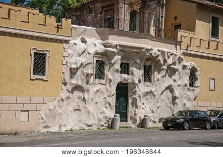Roma, Italy - May 24, 2013. Front view of house with creative and unusual street decor on a sunny day in Rome, the incredible city of the Ancient Era, known as