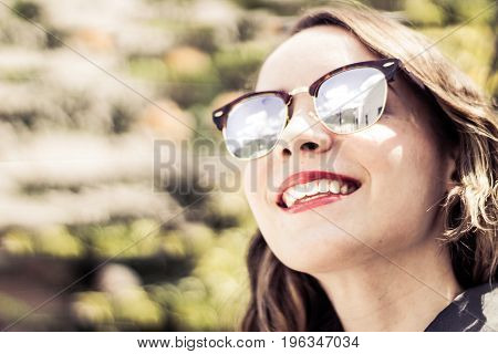 Young Modern Woman With Sunglasses And Casual Expression