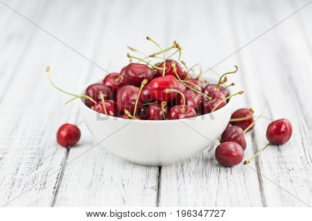 Fresh Cherries On Vintage Wooden Background