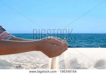 Sand Flowing Through The Hands.