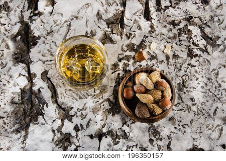 Granite countertop white galaxy stone with drink and nuts on