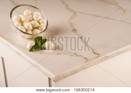 White kitchen cabinets with elegant marble countertop and mozzarella on it. Isolated colorful marble stone countertops for bathroom and kitchen cabinets. Stone, Bathroom, Kitchen, Countertops, Counters, Granite, Marble, Floor, Tiles, Slabs