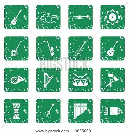 Musical instruments icons set in grunge style green isolated vector illustration