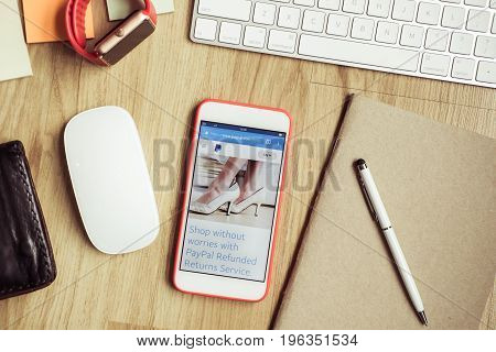 Chiang Mai Thailand - July 21 2017 An iphone 6 on a table with a keyboard and mouse. Open on the phone is the Paypal application