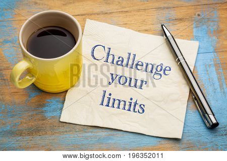 Challenge your limits motivational advice or reminder - handwriting on a napkin with a cup of espresso coffee