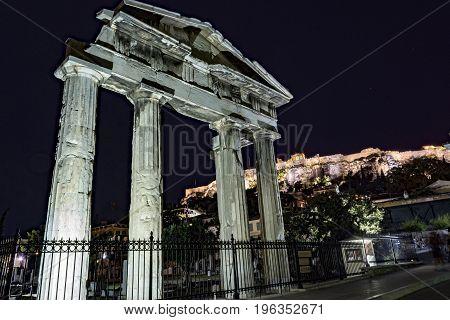 entrance of roman agora athens greece, acropolis in far view