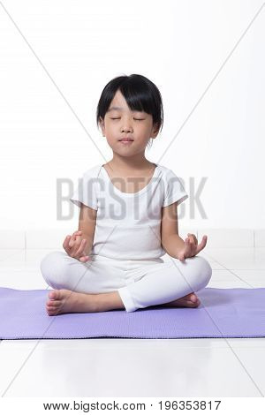 Asian Chinese Little Girl Practicing Yoga Pose